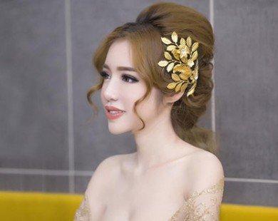 Ngắm phong cách thời trang lộng lẫy, gợi cảm của Elly Trần