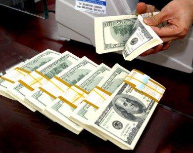 Tỷ giá giảm ngân hàng chặn đà rơi